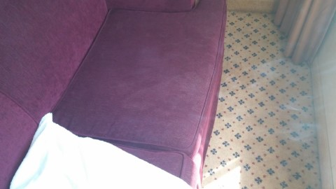 Stain on 80's couch.  Once again, looks like  someone had to pee really bad.